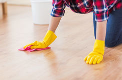 Close up of woman with rag cleaning floor at home Royalty Free Stock Image