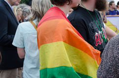 Close up of woman with rainbow gay flag on back Stock Photo