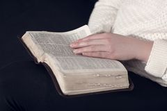 Close up of a woman reading the Bible Stock Image