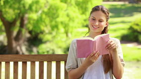 Close up of a woman reading a book stock video footage