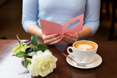 Close up of woman reading greeting card and coffee Stock Photos