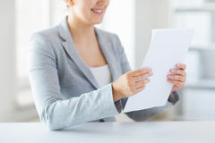 Close up of woman reading papers or tax report Royalty Free Stock Photo