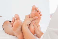 Close-up of a woman receiving foot massage Stock Photo