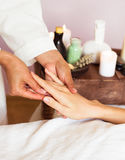 Close-up. Woman receiving a hand massage at the health spa. Stock Photo