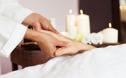 Close-up. Woman receiving a hand massage at the health spa. royalty free stock photography