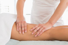 Close-up of a woman receiving leg massage Stock Image