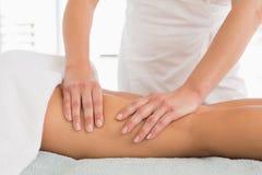 Close-up of a woman receiving leg massage Stock Image