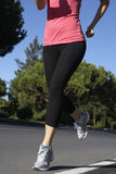 Close Up Of Woman Running On Road Stock Photo