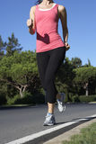 Close Up Of Woman Running On Road Stock Photography