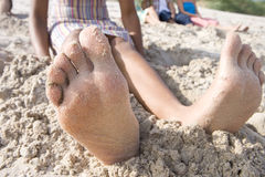 Close-up of woman's barefeet in sand at beach Royalty Free Stock Photo