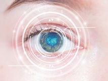 Close-up of woman's blue eye. High technology Royalty Free Stock Image