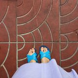 Close up of a Woman's Blue Slippers Buddhist Walking on Street or Ground for Relaxation and Meditation Stock Images