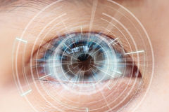 Close-up of woman's brown eye. High Technologies in the future.  Stock Images