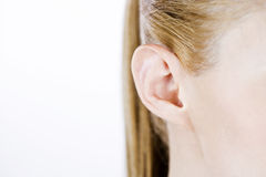 Close-up of a woman's ear, right side Royalty Free Stock Image