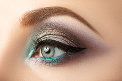 Close-up of woman's eye with creative modern make-up Royalty Free Stock Photo