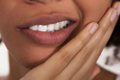 Woman Having Tooth Pain. Close-up Of A Woman`s Face Having Tooth Pain stock images
