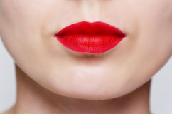 Close up of a woman's face wearing red lipstick Stock Photography