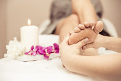 Close up of woman's feet and beauty saloon decorations Stock Image