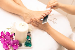 Close up of woman's feet and beauty saloon decorations Royalty Free Stock Photos