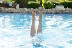 Close up of a woman`s feet splashing out of the water. At resort Royalty Free Stock Photos