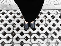 Close Up on Woman`s Feet Wearing Black Sandals & Dress, Standing Commemorate on the Street Stock Photos