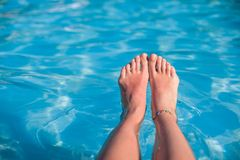 Close-up of a woman's foot in the water Royalty Free Stock Photo
