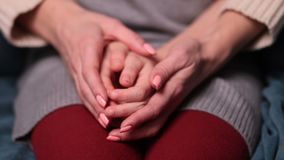 Close up of woman`s and girl`s hands caressing Stock Photo
