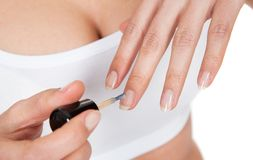 Woman Applying Nail Paint Stock Images