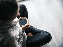 Close-up of a woman`s hand holding a cup of hot coffee. fashion, leisure Royalty Free Stock Photos