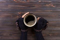Close-up of a woman's hand holding a cup of hot coffee. fashion, leisure Royalty Free Stock Photo