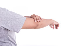 Close up woman's hand holding her elbow isolated on white. Elbow. Close up woman's hand holding her elbow isolated on white background. Elbow pain concept Stock Images