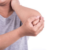 Close up woman's hand holding her elbow isolated on white. Elbow. Close up woman's hand holding her elbow isolated on white background. Elbow pain concept Royalty Free Stock Images