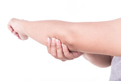 Close up woman's hand holding her elbow isolated on white. Elbow Royalty Free Stock Photos