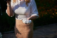 Hands holding a pillow with wedding rings royalty free stock photography
