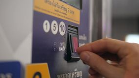 Close Up of Woman`s Hand Paying by Coins Subway Ticket in Automatic Vending Machine. 4K. Close Up of Woman`s Hand Paying by Coins Subway Ticket in Automatic stock video