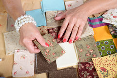Close up of woman's hand sewing patchwork Royalty Free Stock Photos