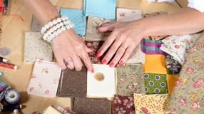 Close up of woman's hand sewing patchwork Stock Images