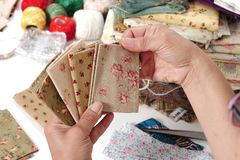 Close up of woman`s hand sewing patchwork Stock Photos