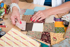 Close up of woman's hand sewing patchwork Stock Image