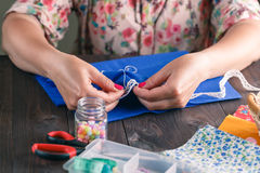 Close-up of woman's hand stitching quilting stock images
