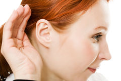 Close up of woman's hand to his ear . Royalty Free Stock Image