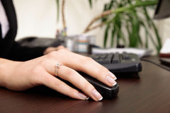 Close-up of woman's hand working on the computer Royalty Free Stock Image