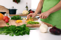 Close up of woman`s hands cooking in the kitchen. Housewife slicing fresh salad. Vegetarian and healthily cooking. Concept Royalty Free Stock Photos