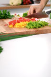Close up of woman`s hands cooking in the kitchen. Housewife slicing fresh salad. Vegetarian and healthily cooking. Concept Stock Photo
