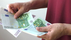 Close up of woman's hands counting euro bills stock video footage