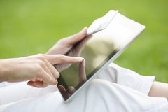 Close-up woman's hands holding a credit card and using tablet pc Stock Photos