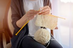 Close up on woman's hands knitting Stock Photos