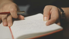 Close-up of woman's hands open notebook. stock video
