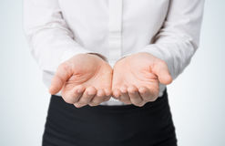 Close-up of woman's hands, palms up. A woman dressed in formal clothes. Royalty Free Stock Photos