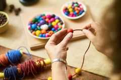 Designer making handmade jewelry stock photo